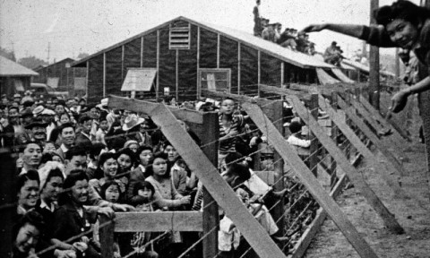 Japanese-American citizens corralled together in an internment camp
